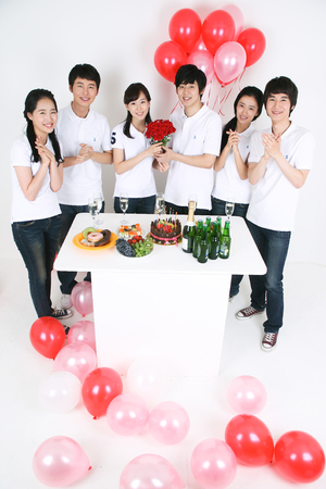 Party Concept - Young Asian people having a party, isolated on white Editorial