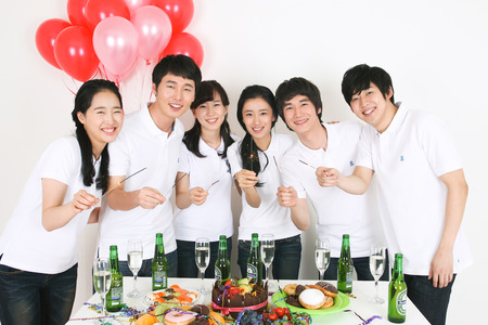 Party Concept - Young Asian men having a party, isolated on white Editorial