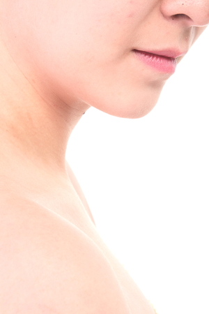 Beauty Concept - Close up shot of Asian womans fresh skin, isolated on white
