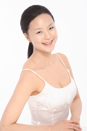 Beauty Concept - Beautiful Asian woman with perfect skin, isolated on white Stock Photo