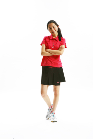 athletic wear: Asian female student in tennis wear - isolated on white