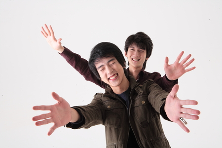 Two young guys in the studio,isolated on white. Stock Photo