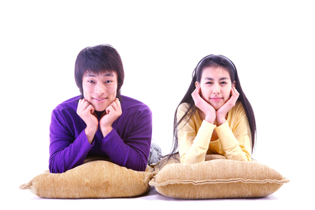 two persons only: Young people with props in the studio,isolated on white. Stock Photo