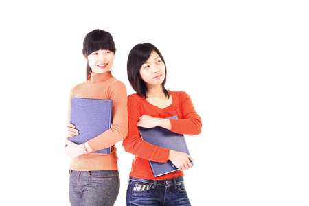 two persons only: Two girls in the studio,isolated on white.