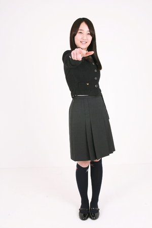 nobleness: An Asian girl student with cute poses in the studio, isolated on white.