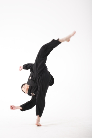 somersault: Asian martial arts master - isolated on white
