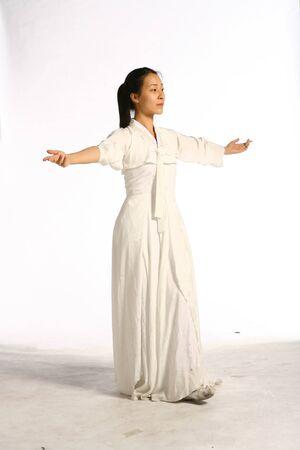 Beautiful Korean female dancer in Korean traditional clothing, hanbok - isolated on white Stock Photo