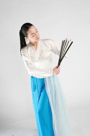 hanbok: Beautiful Korean female dancer in white Korean traditional dress, Hanbok - isolated on white