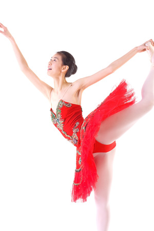 Beautiful asian ballet dancer in a red tutu - isolated on white Stock Photo
