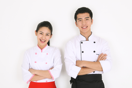Young Asian chefs in a studio - isolated on white