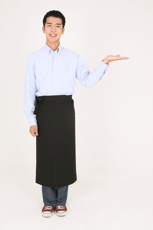 Young Asian waiter in a studio - isolated on white Stock Photo