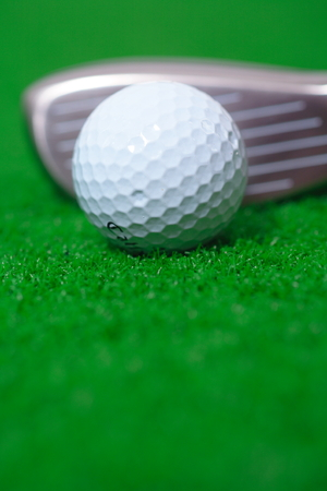 Close-up shot of a golf ball with a driver Stock Photo