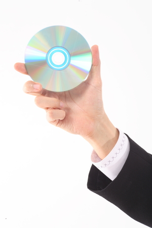 Close-up shot of a hand holding a CD