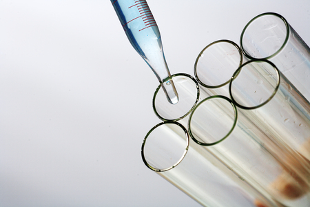 Close-up shot of test tubes and a lab spuit Stock Photo