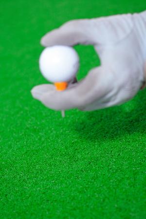 Close-up shot of a hand holding a golf ball