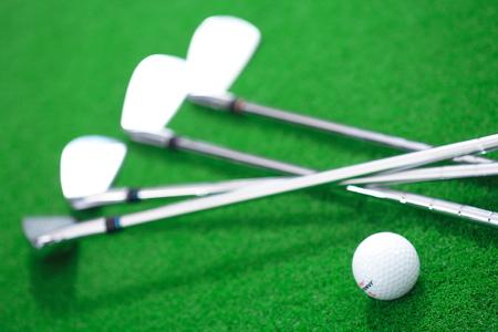 Close-up shot of golf balls and golf clubs