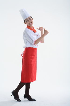 A female cook with hand gesture