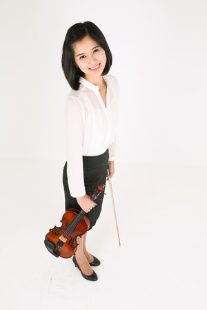 A female violinist holding a violin and a bow