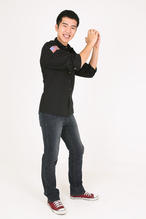 A male bartender standing with hand gesture
