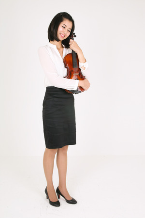 gifted: A female violinist holding a violin in arms