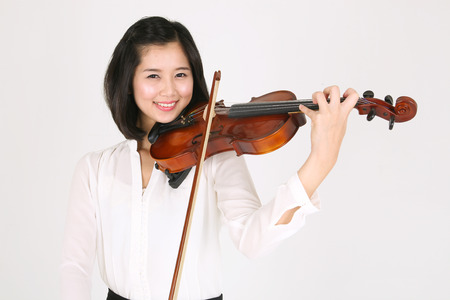 A female violinist playing the violin Stock Photo