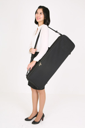 A female violinist carrying a violin case Stock Photo
