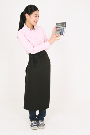 A young waitress holding a calculator