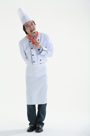 A male cook holding a metal ladder
