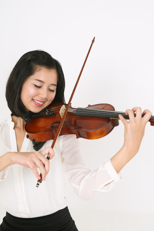 gifted: A female violinist playing the violin with eyes closed