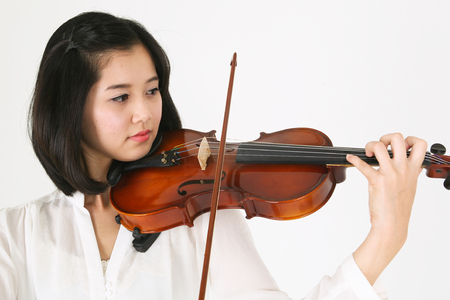 instrumentalist: Close up shot of a female violinist playing the violin
