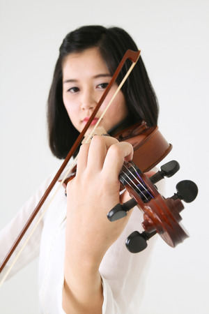 gifted: Close up shot of a female violinist playing the violin
