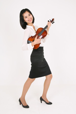 instrumentalist: A female violinist holding a violin like a guitar in running motion