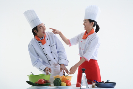 korean salad: A couple of cooks playing while cooking