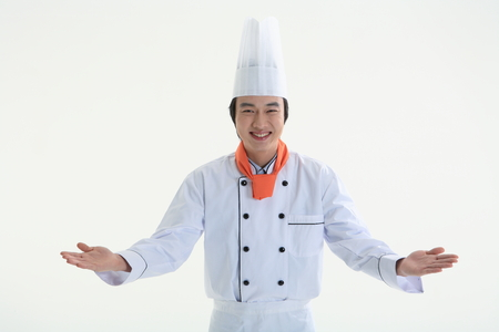 A male cook welcoming customers