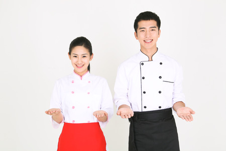 A male cook and a female cook with hand gesture