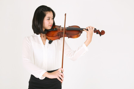 Close up shot of a female violinist playing the violin
