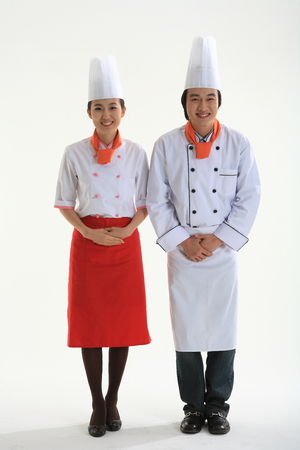 A male cook and a female cook greeting