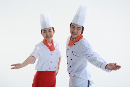 A couple of cook making hand gesture