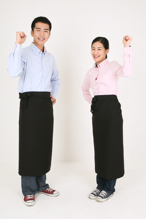 A waiter and a waitress in cheerful pose