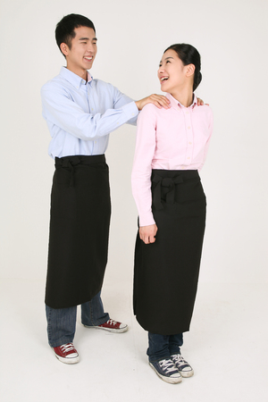 A waiter and a waitress giving massages each other
