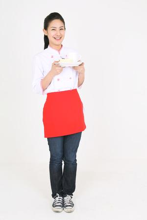 sho: A female cook carrying a dessert plate