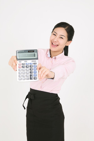 calculator chinese: A young waitress holding a calculator