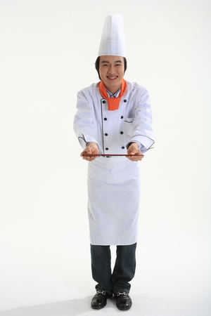 A male cook holding chopsticks Stock Photo