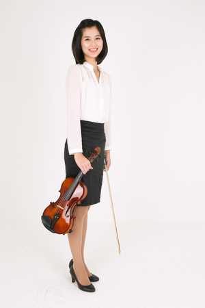 instrumentalist: A female violinist holding a violin and a bow