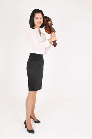 instrumentalist: A female violinist holding a violin like a bat
