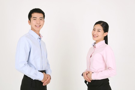 A waiter and a waitress facing each other Stock Photo