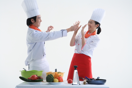 A couple of cooks playing while cooking