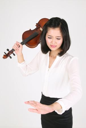 instrumentalist: A female violinist in frustration