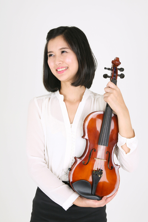 instrumentalist: A female violinist holding a violin in arms
