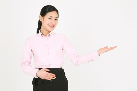 A young waitress with introducing hand gesture